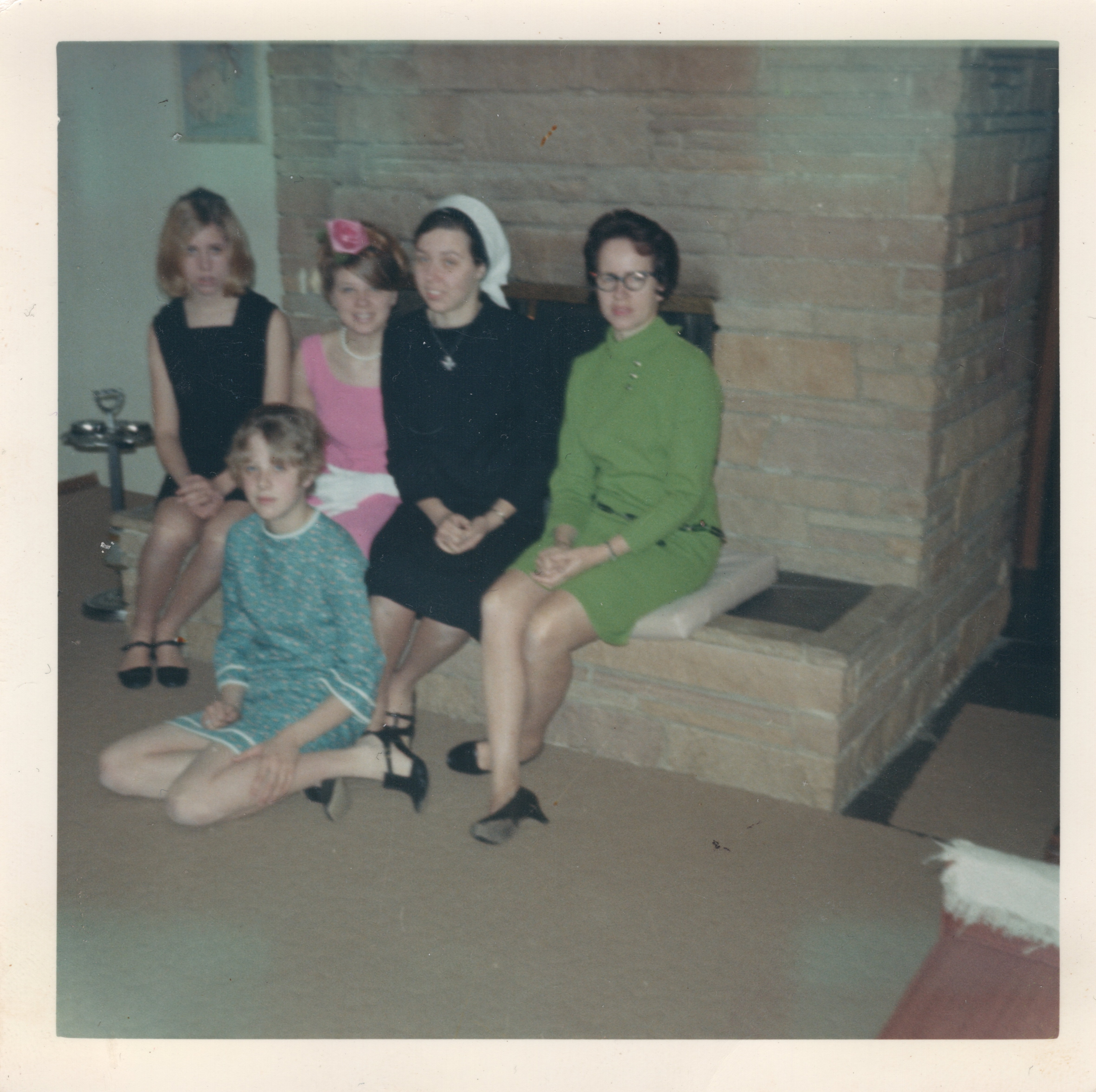 Photo of Judy in August of 1968 with her mother and siblings after having given her first vows.